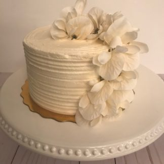 ridge cake, buttercream icing, custom cake, flower topper