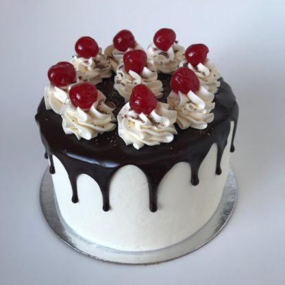 black forest cake, buttercream icing, cherries, chocolate ganache