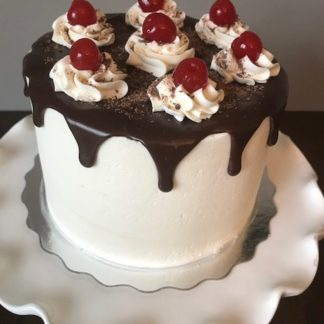 black forest cake, buttercream icing, cherry