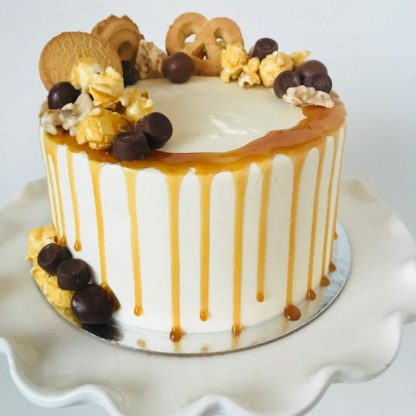 vanilla caramel cake, buttercream icing, candy, chocolate