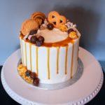 vanilla caramel cake, buttercream icing, drip cake, cookies, candy