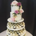 wedding cupcake tower, three tier cake, flowers, mini cupcakes