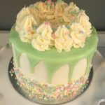 custom cake, sprinkles, gender reveal, buttercream icing, chocolate ganache