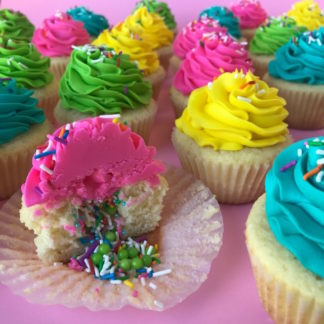pinata cupcakes, sprinkles, buttercream icing